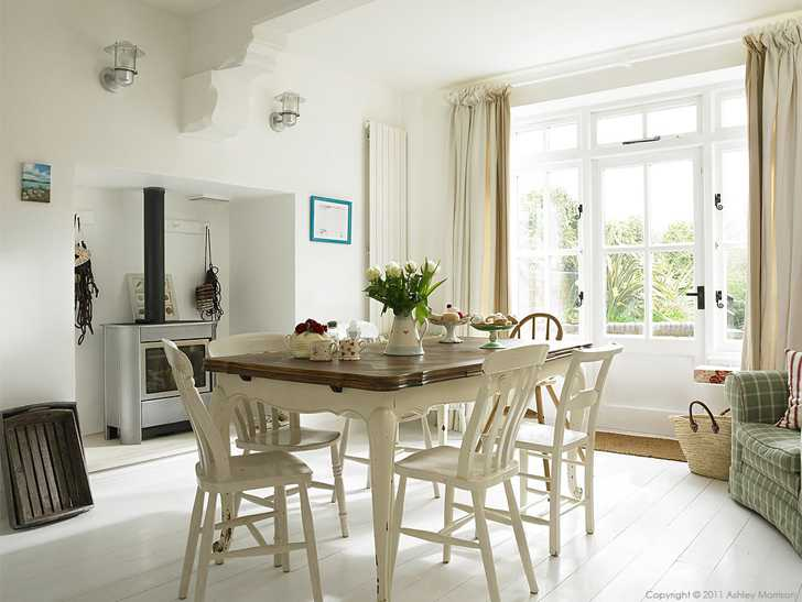 The kitchen table in Beth & Jason Cooper's three story period terrace in the West Sussex town of West Wittering.