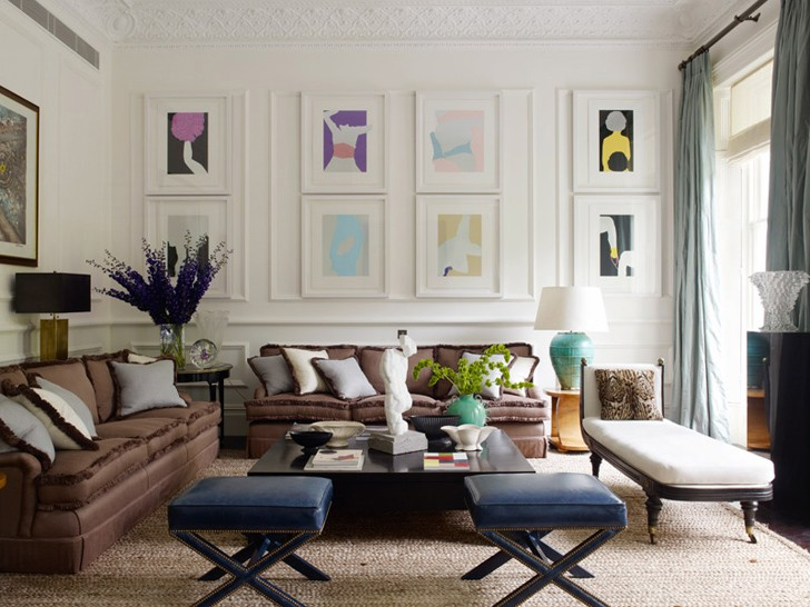 Prints by Gary Hume decorate an entire wall of this elegant living room