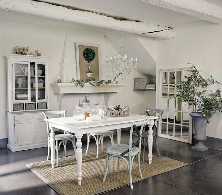белая мебель и серый вазон в интерьере кухни