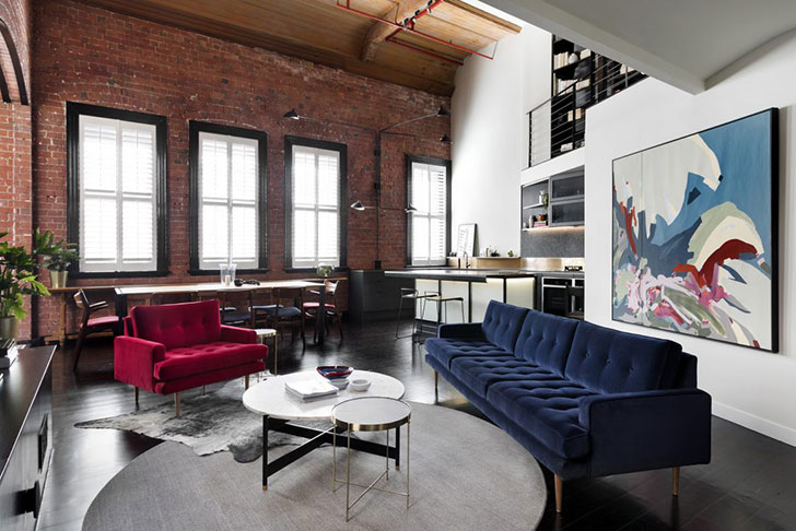 Loft apartment with a brick wall and bright furniture in ...