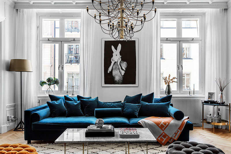 Gorgeous Velvet Sofa Of Deep Blue Shade In The Center Living Room This Apartment Stockholm Like Throne Modern King Spectacular