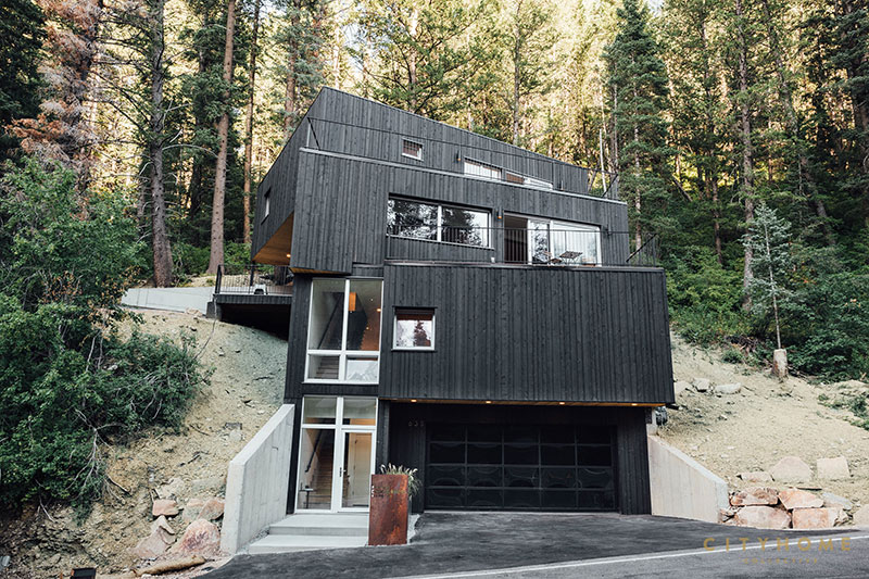 Wooden House That Is Built Into Forest Slope Photos