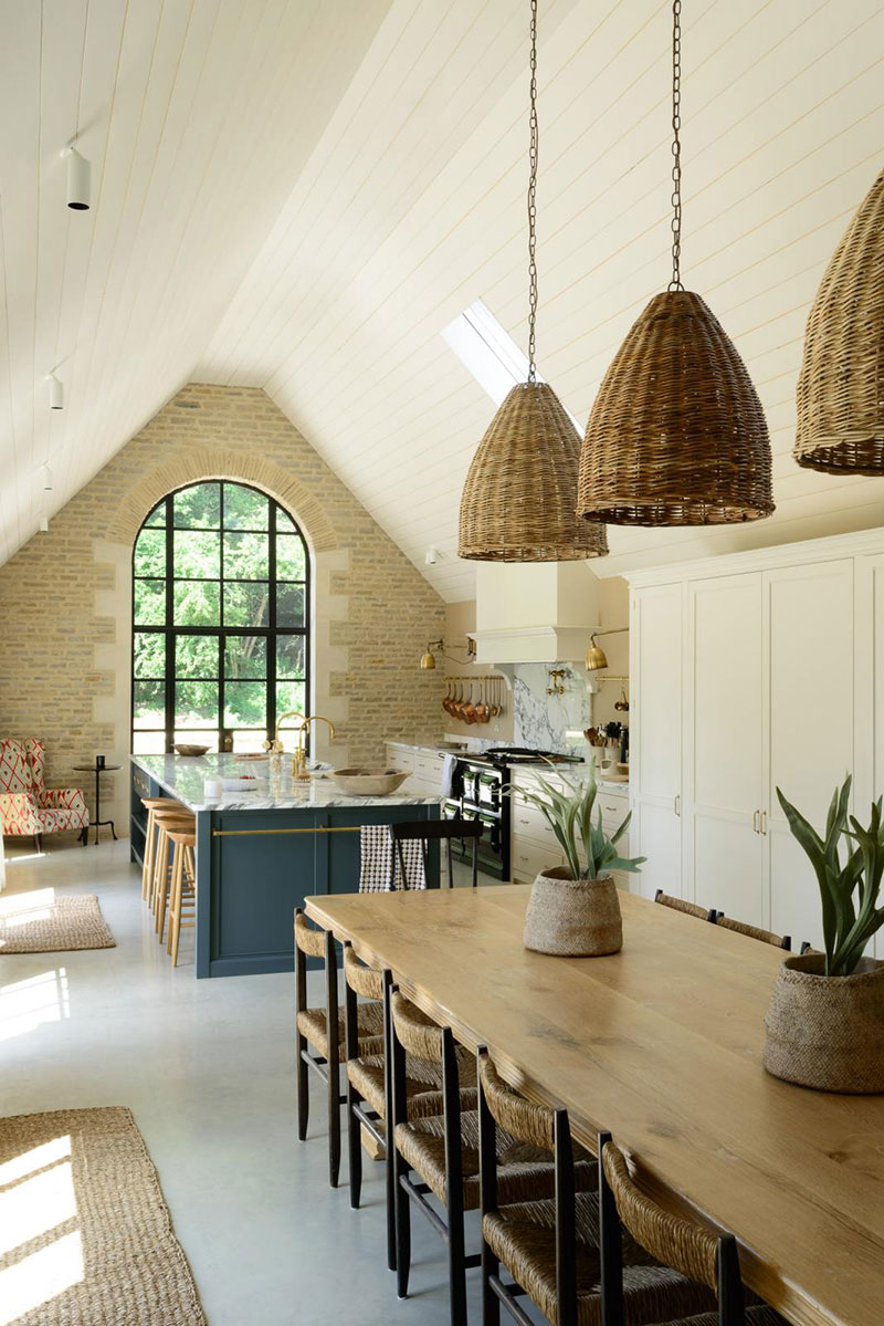 As a result the new kitchen inherited beautiful architectural features such as large arched windows and sloping ceilings dream interior