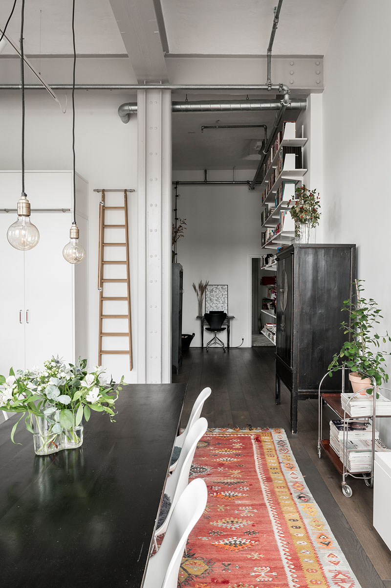 On the other hand the light scandinavian decor and colors here soften the space and make it more cozy and comfortable for a family living great mix