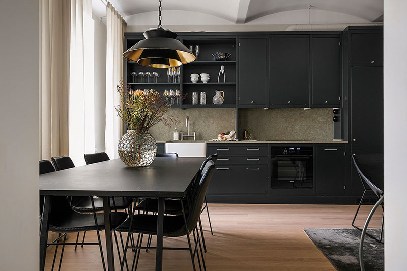 Swedish apartment with black kitchen and large windows (91 sqm)