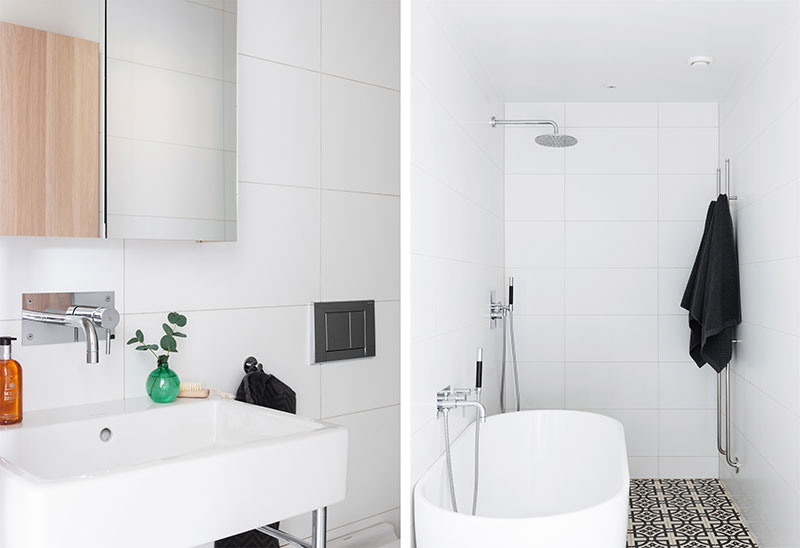 Синяя кухня без верхних шкафчиков и открытая гостиная: приятная квартира в Стокголье (100 кв. м)