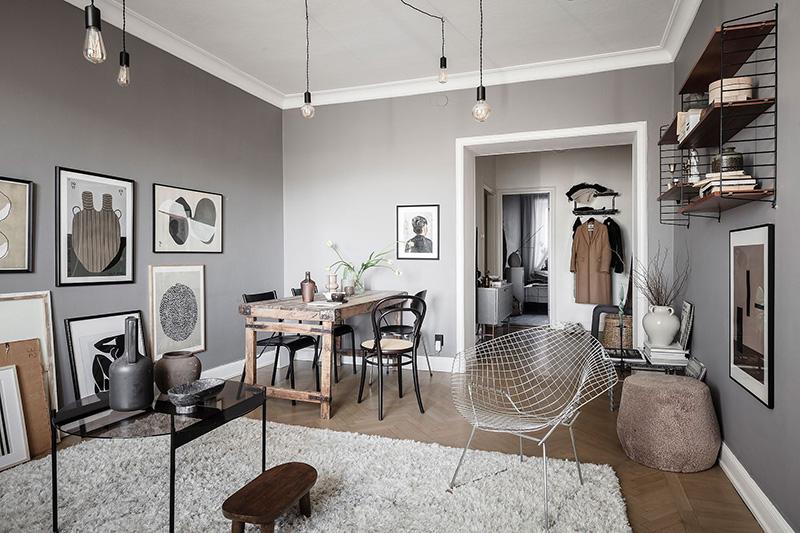 Серые стены в гостиной и кирпичные на кухне: стильная квартира в Гётеборге (51 кв. м)