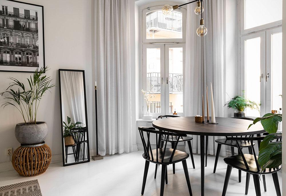 Белый интерьер маленькой квартиры с экзотическими нотками в Швеции (41 кв. м)