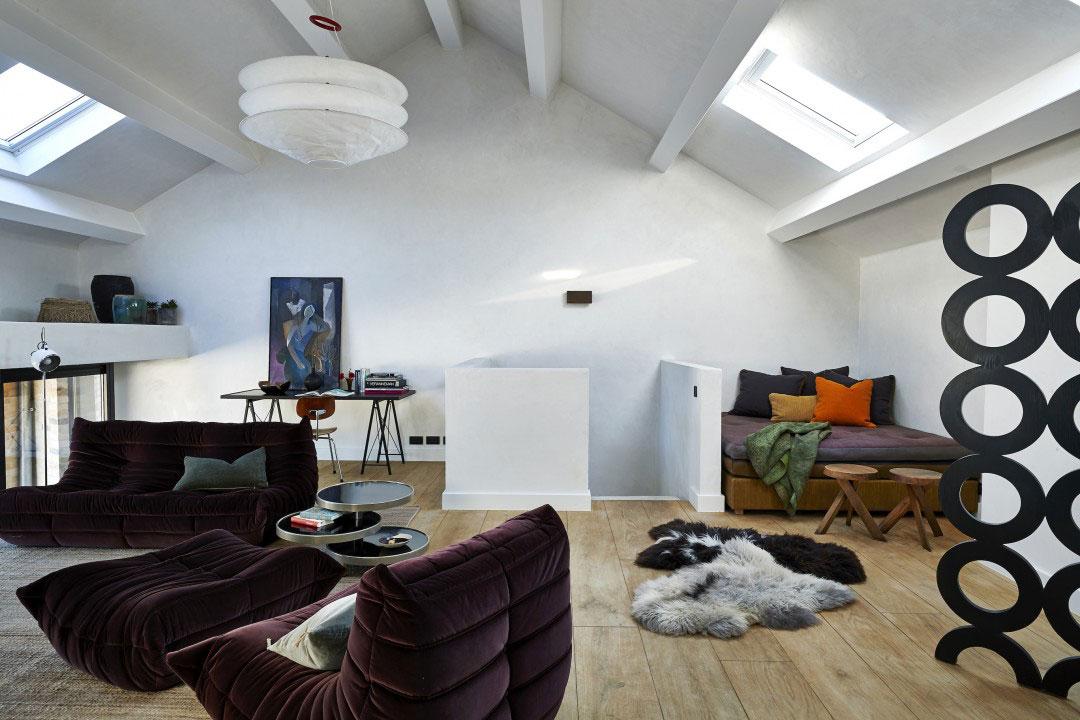 Грубые поверхности и стильная мебель: апартаменты в бывшем стекольном заводе в Генте